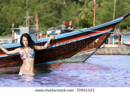 Sexy lady posing in water - stock photo