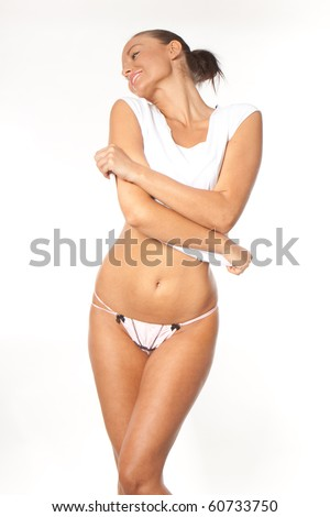 Sexy lady taking off her clothes - stock photo