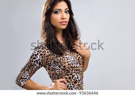 Sexy latin girl in animal print short dress - stock photo