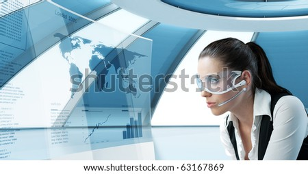 Sexy latina brunette in future glasses and headset. Looking at the transparent screen with interface. Pretty young business people in interiors / interfaces series. - stock photo