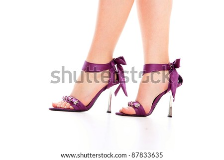 Sexy leg in high heels isolated on white background. - stock photo