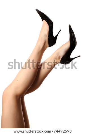 Sexy legs in black high heels isolated on white background. - stock photo