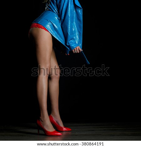 Sexy legs in red high heels - stock photo
