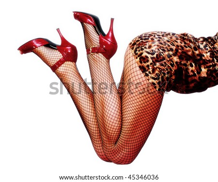 Sexy legs in red shoes and fishnet pantyhose - stock photo
