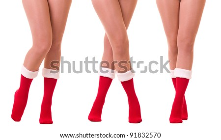 Sexy legs in Santa Claus's sock isolated on white background. - stock photo