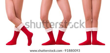 Sexy legs in Santa Claus's sock isolated on white background.