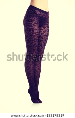 Sexy legs in stockings isolated on white background - stock photo