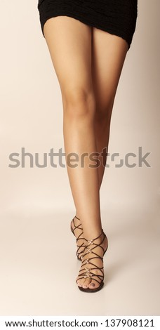Sexy legs of a woman walking towards camera - stock photo