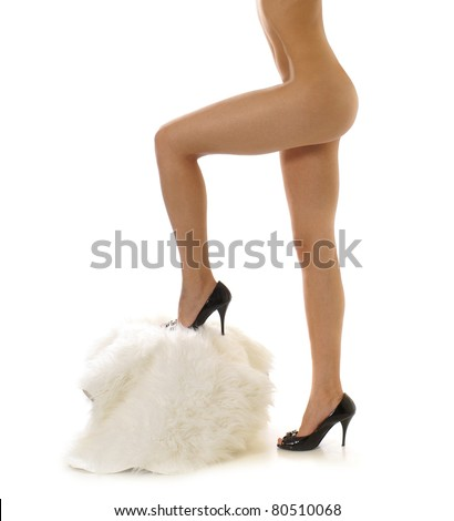 Sexy legs of beautiful woman isolated on white - stock photo