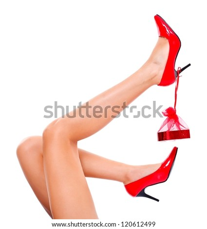 Sexy legs with red shoes and little present for Christmas - stock photo