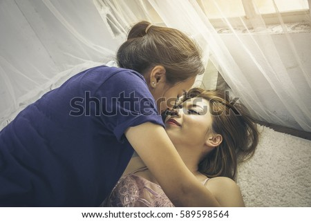 Lesbian Kiss On Bed