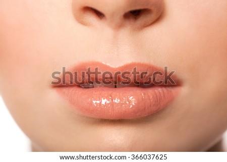 Sexy Lips. Beauty Lipgloss Makeup Detail. Beautiful Make-up Closeup.  - stock photo