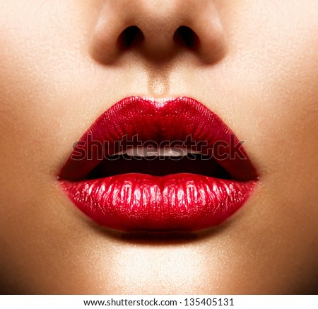 Sexy Lips. Beauty Red Lips Makeup Detail. Beautiful Make-up Closeup. Sensual Open Mouth. lipstick or Lipgloss - stock photo