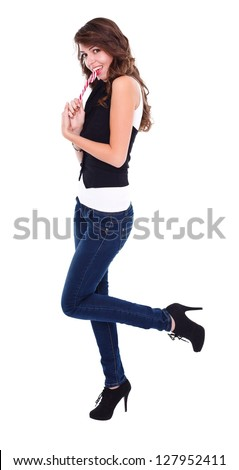 Sexy lollipop girl posing to camera, studio shot - stock photo