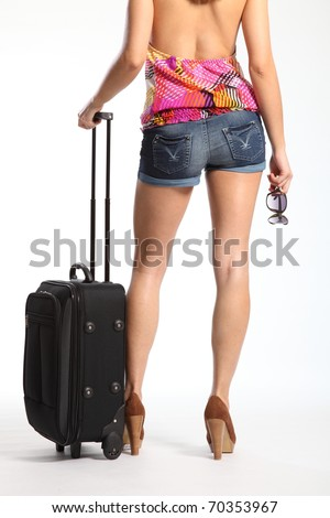 Sexy long legs of woman waiting with suitcase - stock photo