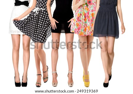 Sexy long legs of women group isolated on white background - stock photo
