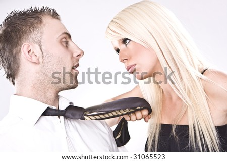 sexy looking couple arguing - blonde girl blonde man - stock photo