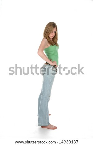 sexy looking woman in blue jeans and green shirt - stock photo