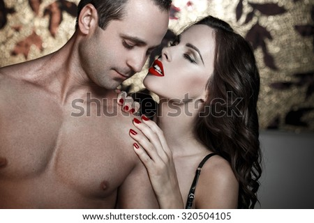 Sexy lovers foreplay at luxury flat, sensual milf foreplay with young man - stock photo