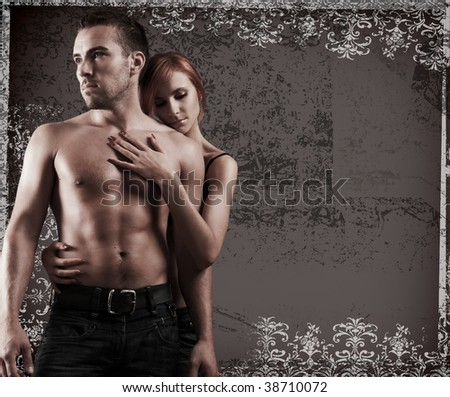sexy loving couple in the dark - stock photo