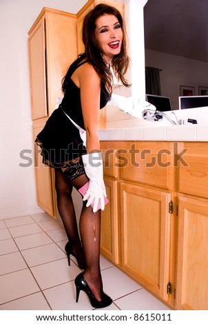 Sexy maid, washing dishes.