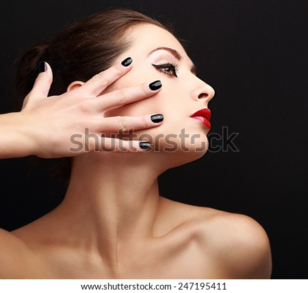 Sexy makeup woman with black nails on face. Woman profile with red lipstick - stock photo
