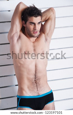 sexy male fitness model in brief shorts