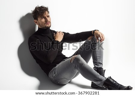 Sexy male model posing - stock photo