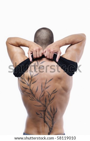 Sexy male's back with tattoo - stock photo