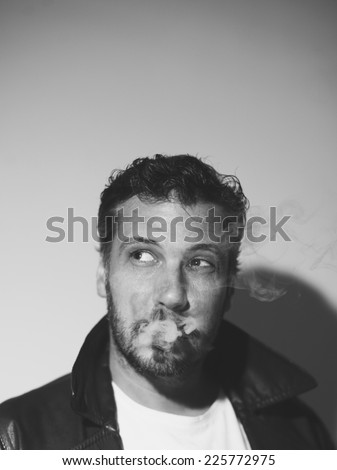 Sexy man face with sunglasses smoking a cigarette, grunge art style, black and white - stock photo