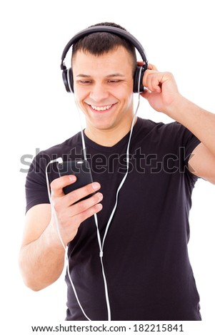 sexy man listening music player on mobile with headphones