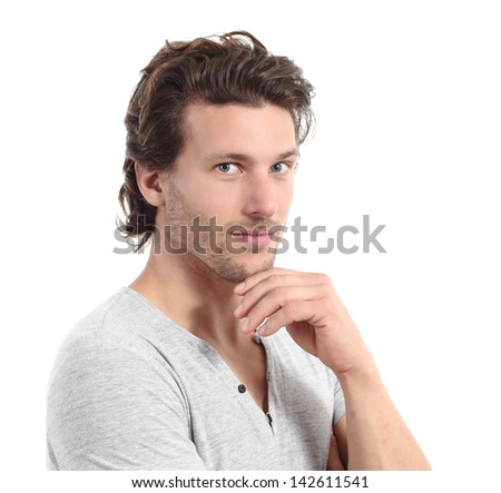 Sexy man looking at camera with the hand on the chin isolated on a white background - stock photo