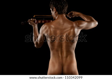 sexy man playing the violin. isolated on a black background