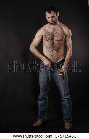 Sexy Man Removing Belt - stock photo