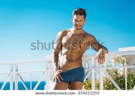 Sexy man wear swimming trunks  - stock photo