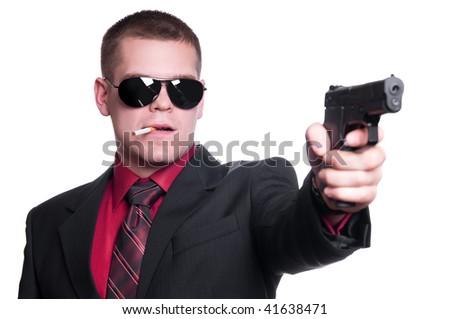 Sexy man with gun - stock photo