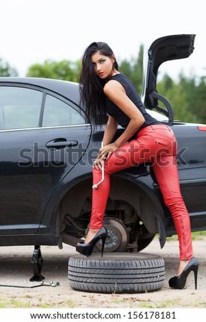 Sexy mechanic repairing the car - stock photo