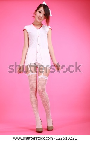 Sexy medic woman with white background - stock photo