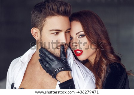 Sexy milf woman with young macho lover indoor - stock photo