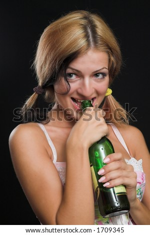 Sexy model holding a beer bottle - very high resolution - stock photo