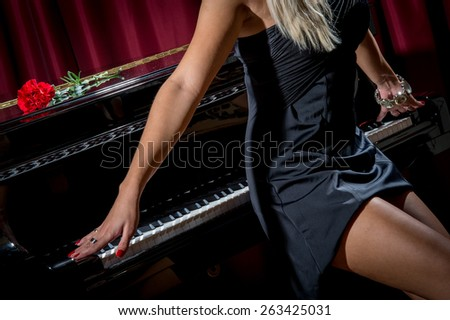 Sexy model in underwear posing with the piano for fashion shoot - stock photo
