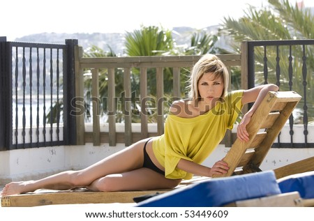 Sexy model laying on summer terrace in Bodrum - Turkey - stock photo
