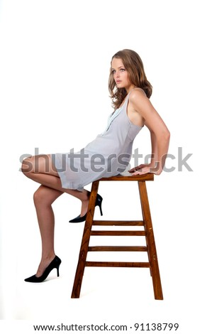 sexy model sitting on chair