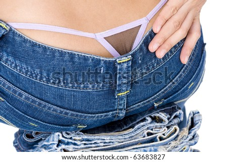 sexy model sitting on jeans, isolated on white background - stock photo