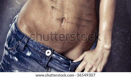 sexy model with wet and dirty skin and hair - stock photo