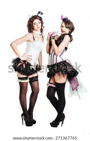 Sexy moulin rouge lesbian girls wearing hot lingerie. Woman in style pin up courtesan fashion. Glamorous sexy woman in Moulin Rouge style hat and sequins fashion cabaret party - stock photo