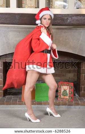 Sexy Mrs. Santa Claus by fireplace - Christmas