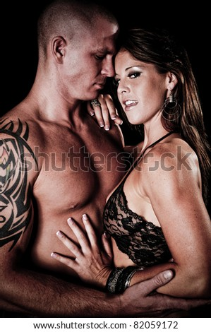 Sexy Muscular Couple Holding each other - stock photo