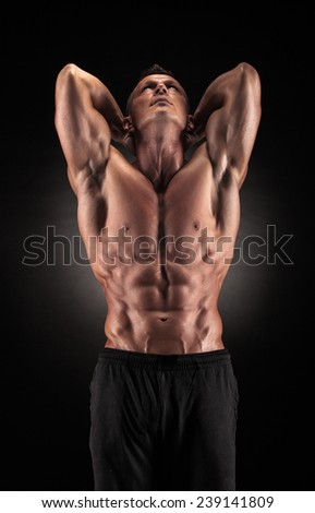 Sexy muscular guy in the studio shows the various movements - stock photo