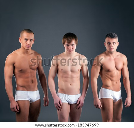 Sexy muscular guys advertises briefs in studio